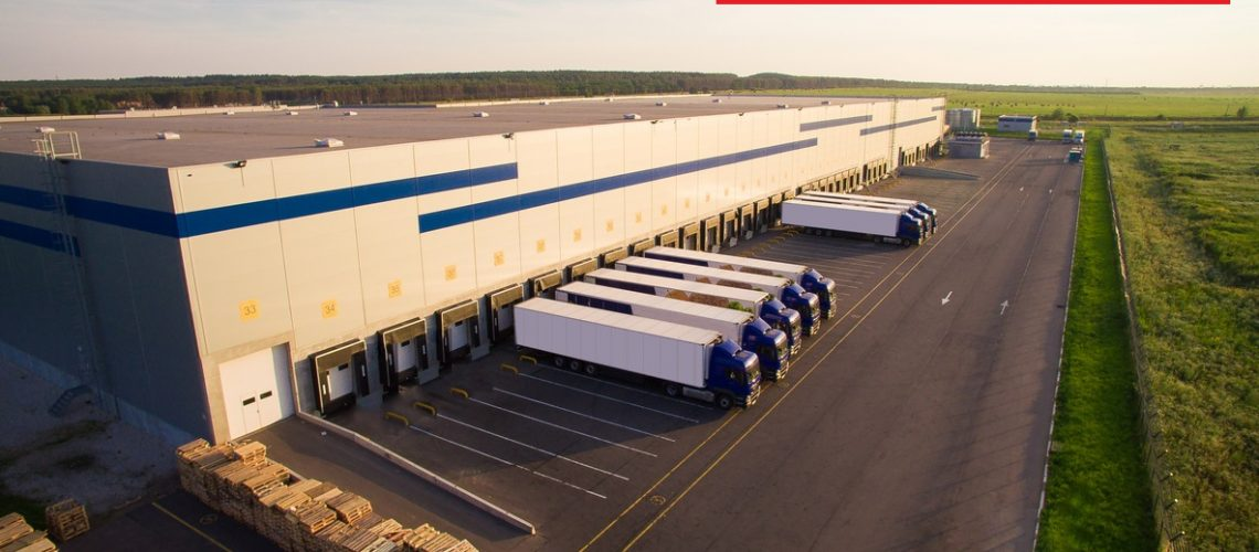 distribution warehouse with trucks of different capacity.